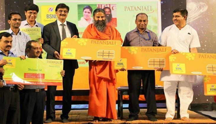 Baba Ramdev's Patanjali ties up with BSNL for Swadeshi Samriddhi SIM cards